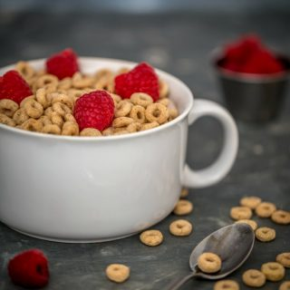 Bowl of Cheerios with Raspberries - Family Breakfast